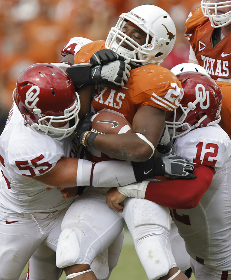 Oklahoma's Jaydan Bird (55) and Travis Lewis (12) stop Texas' Malcolm Brown(28) during the Red River Rivalry college football game between the University of Oklahoma Sooners (OU) and the University of Texas Longhorns (UT) at the Cotton Bowl in Dallas, Saturday, Oct. 8, 2011. Photo by Chris Landsberger, The Oklahoman