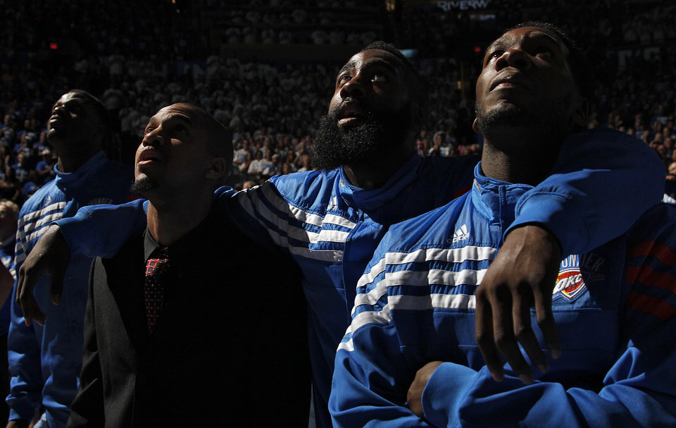 Photo - Oklahoma City's Eric Maynor, James Harden and Royal Ivey watch the jumbotron during Game 2 in the second round of the NBA playoffs between the Oklahoma City Thunder and the L.A. Lakers at Chesapeake Energy Arena on Wednesday,  May 16, 2012, in Oklahoma City, Oklahoma. Photo by Chris Landsberger, The Oklahoman