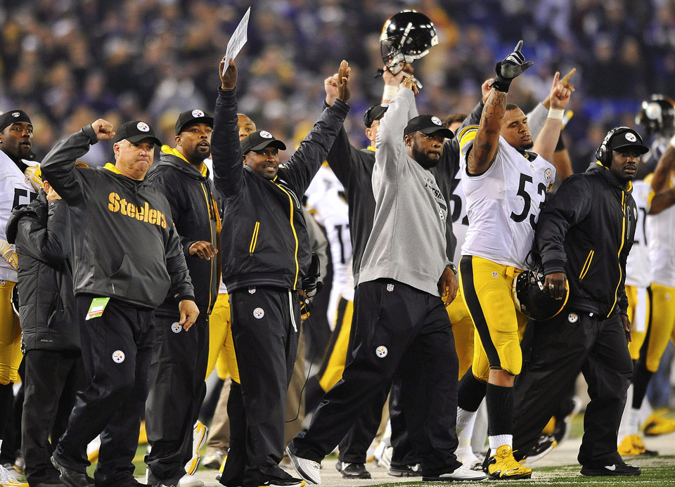Photo - Pittsburgh Steelers head coach Mike Tomlin, center, joins the rest of the bench in celebrating the winning field goal during the second half of an NFL football game against the Baltimore Ravens in Baltimore, Sunday, Dec. 2, 2012. The Steelers won 23-20. (AP Photo/Gail Burton)