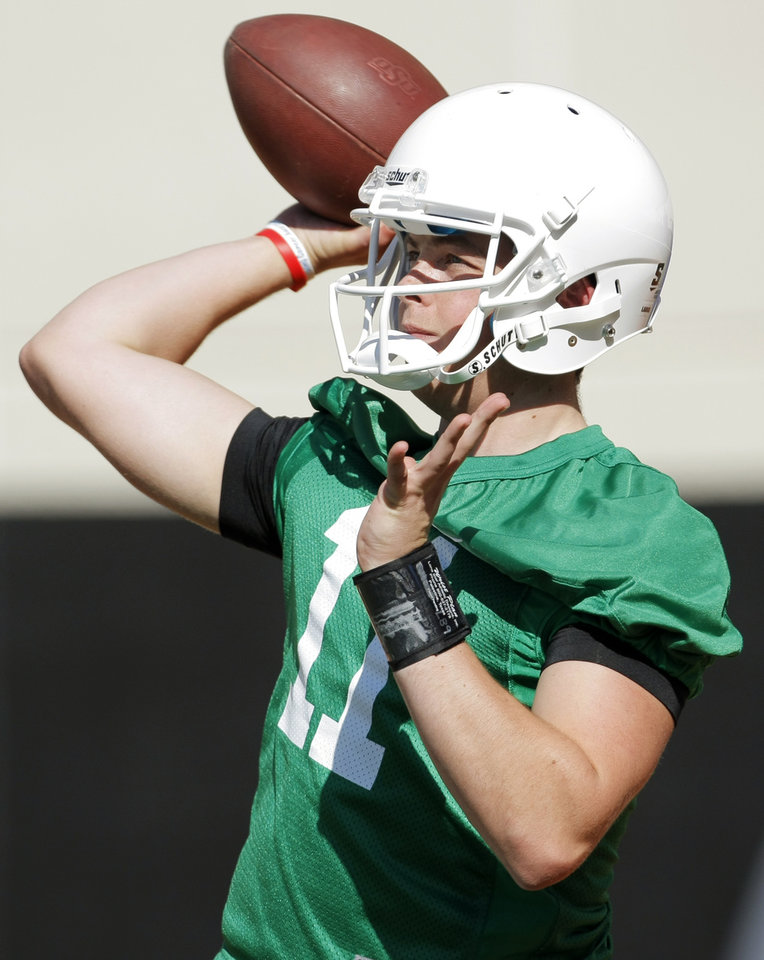 Photo - Wes Lunt (11) passes the ball during the OSU spring football practice at Boone Pickens Stadium on the campus of Oklahoma State University in Stillwater, Okla., Monday, March 12, 2012. Photo by Nate Billings, The Oklahoman
