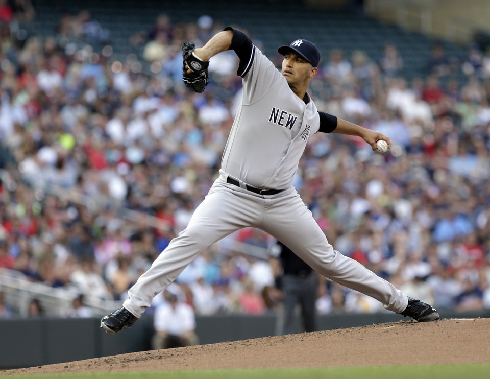 Photo - New York Yankees pitcher Andy Pettitte throws against the Minnesota Twins in the first inning of a baseball game, Monday, July 1, 2013, in Minneapolis. (AP Photo/Jim Mone)