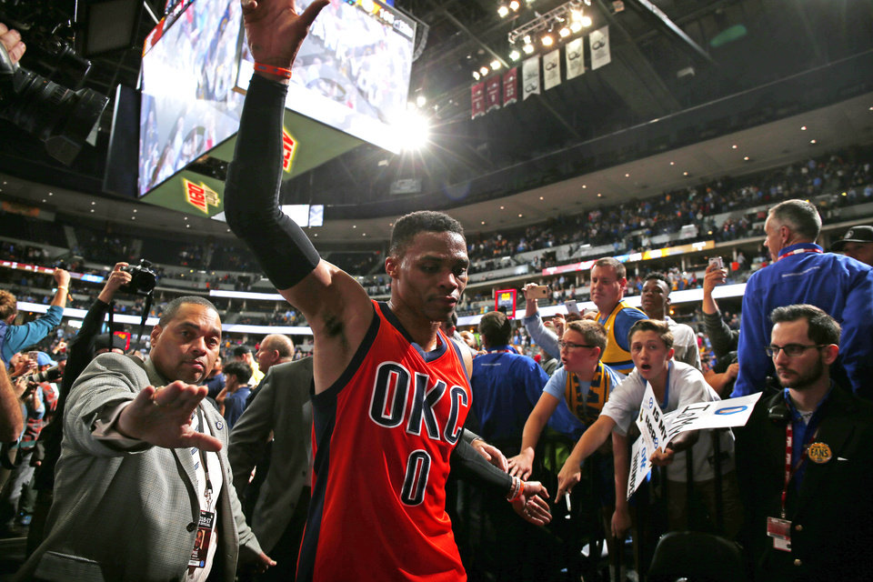 Photo - Oklahoma City Thunder guard Russell Westbrook celebrates after hitting a buzzer beating three point shot to win the game against the Denver Nuggets Sunday, April 9, 2017, in Denver. Oklahoma City defeated Denver 106-105. Westbrook also broke the NBA record for triple doubles with 42 for the season. (AP Photo/Jack Dempsey)