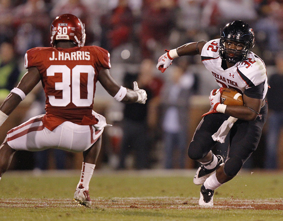 Texas Tech's Aaron Crawford (32) runs past Oklahoma's Javon Harris (30) during the college football game between the University of Oklahoma Sooners (OU) and Texas Tech University Red Raiders (TTU) at the Gaylord Family-Oklahoma Memorial Stadium on Saturday, Oct. 22, 2011. in Norman, Okla. Photo by Chris Landsberger, The Oklahoman  ORG XMIT: KOD