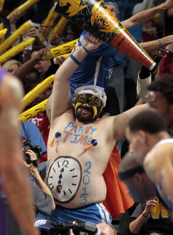 "Garrett Haviland, who calls himself ""Thundor,"" distracts a Phoenix shooter with his New Year's Eve garb as the Oklahoma City Thunder play the Phoenix Suns in NBA basketball at the Chesapeake Energy Arena in Oklahoma City, on Monday, Dec. 31, 2012.  Photo by Steve Sisney, The Oklahoman"