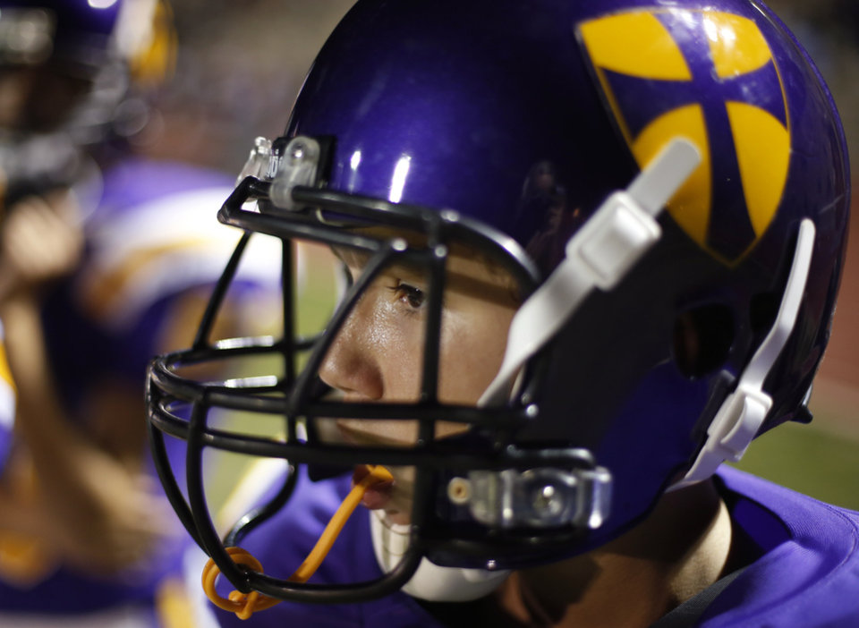 A player watches the game at the Northwest Classen vs. Western Heights high school football game at Taft Stadium Thursday, September 20, 2012. Photo by Doug Hoke, The Oklahoman
