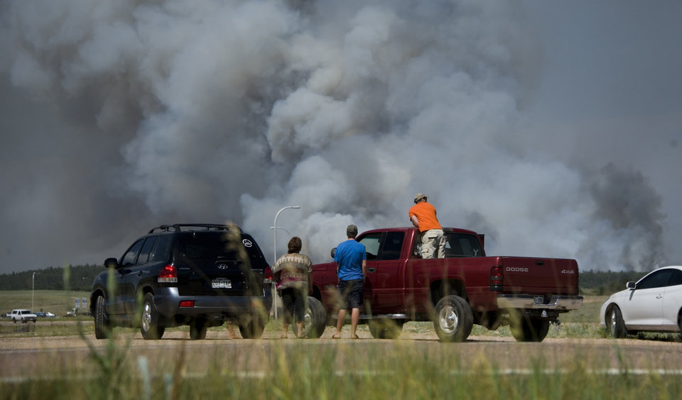 Motorists stop along Interquest Parkway in Colorado Springs, Colo. Tuesday, June 11, 2013, to watch the advance of a wildfire burning in Black Forest.  (AP Photo/The Colorado Springs Gazette, Mark Reis) MAGS OUT
