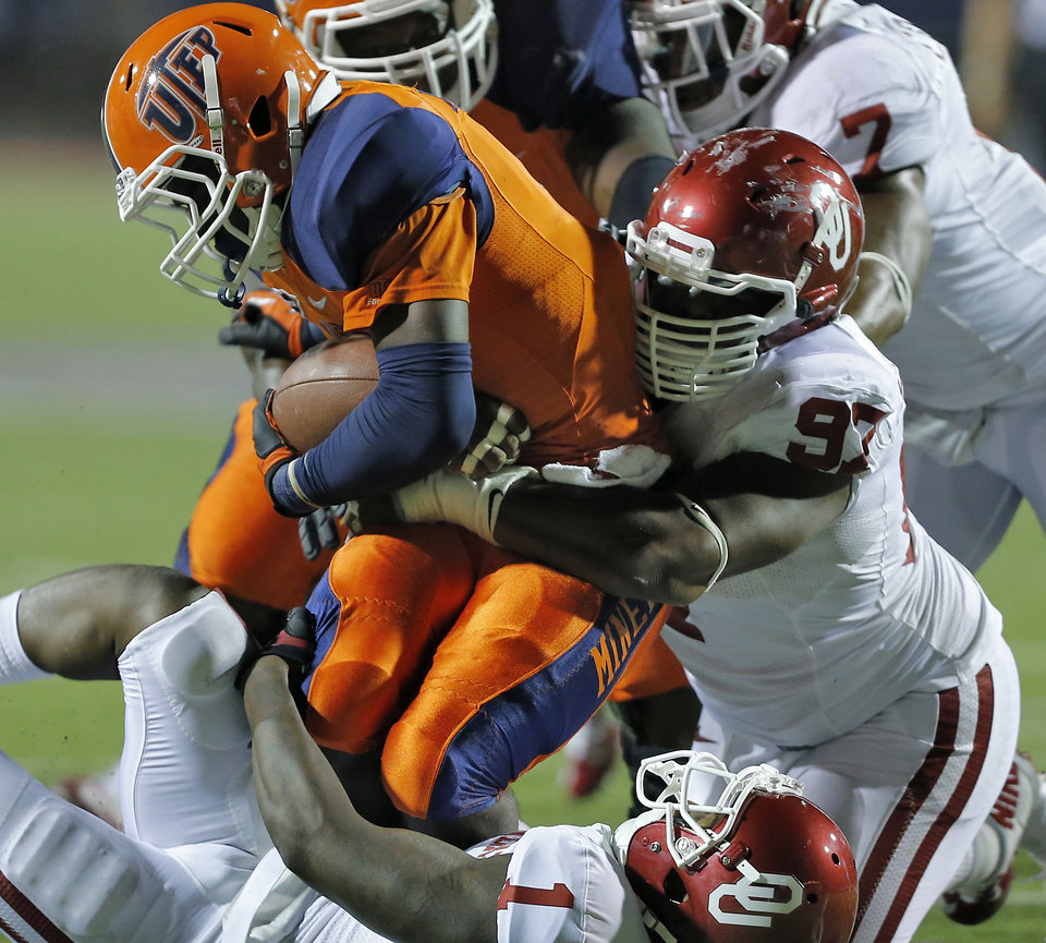 Photo - Oklahoma Sooners defensive tackle Jamarkus McFarland (97) and Oklahoma Sooners defensive back Tony Jefferson (1) bring down UTEP Miners running back Xay Williams (4) during the college football game between the University of Oklahoma Sooners (OU) and the University of Texas El Paso Miners (UTEP) at Sun Bowl Stadium on Sunday, Sept. 2, 2012, in El Paso, Tex.  Photo by Chris Landsberger, The Oklahoman