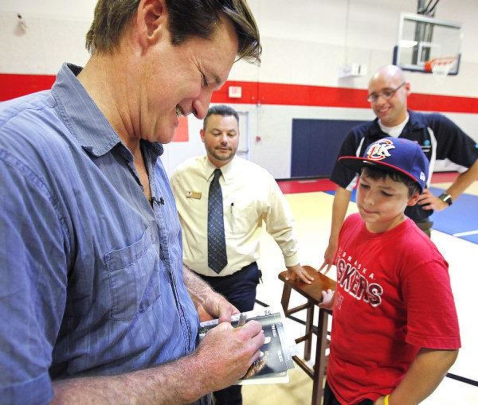 Photo - Actor Bill Pullman signs an autograph for Andrew White, 10,  at the Salvation Army Boys and Girls Club in southwest Oklahoma City, Wednesday, August 4, 2010.     Pullman is in town working on the movie