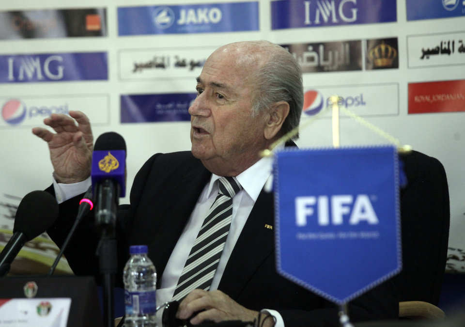 Photo - Sepp Blatter, President of FIFA, speaks during his press conference with Jordan's Prince Ali Bin al-Hussein on the first day of his regional tour to Jordan, Palestinian territories and Israel, in Amman, Jordan, Monday, May 26, 2014. During a joint press conference with Prince Ali at Jordan's Football Association office, Blatter said that his visit to Ramallah and Israel is to defend football in Palestine and also to defend football in Israel. (AP Photo/Mohammad Hannon)