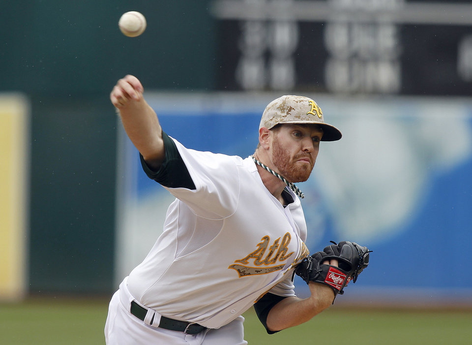 Photo - Oakland Athletics starting pitcher Dan Straily throws to the San Francisco Giants during the first inning of a baseball game in Oakland, Calif., Monday, May 27, 2013. (AP Photo/Tony Avelar)