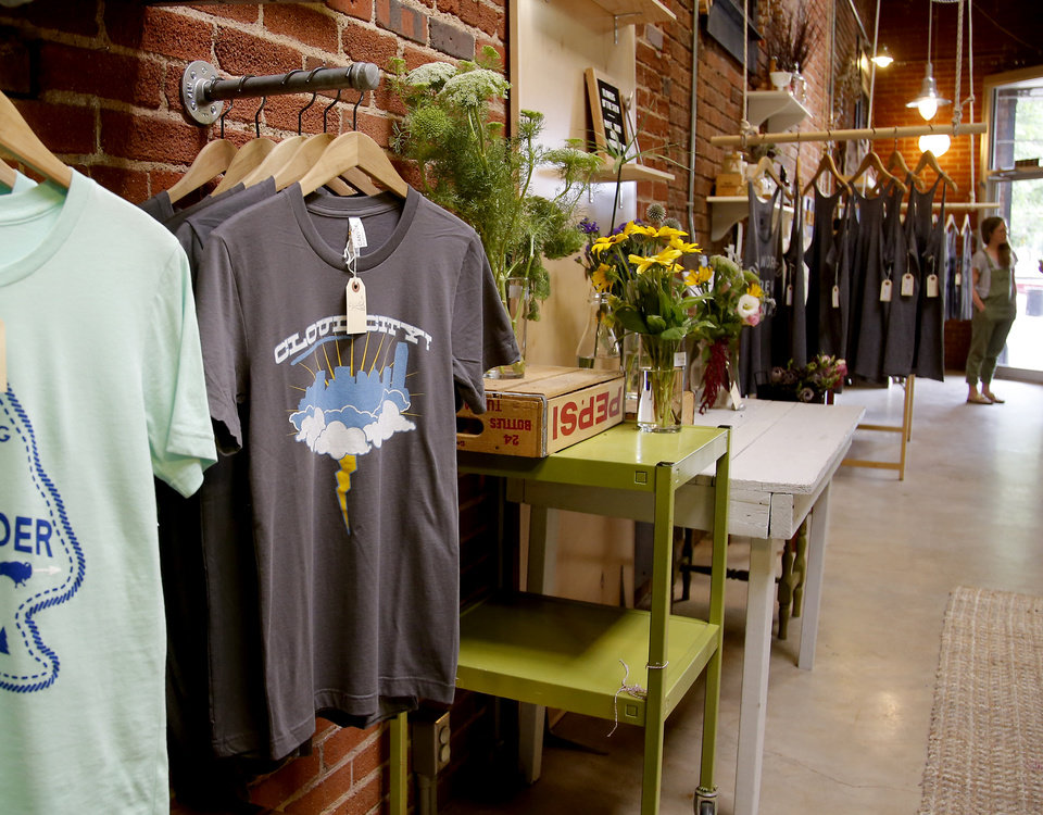 Photo -  Collected Thread, at 1705 A NW 16, offers T-shirts and other products for sale that either are handmade, hand-altered or independently designed.
