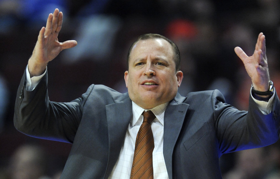 Photo - Chicago Bulls head coach Tom Thibodeau looks on during the first half of an NBA preseason basketball game against the Milwaukee Bucks in Chicago, Monday, Oct. 21, 2013. (AP Photo/Paul Beaty)
