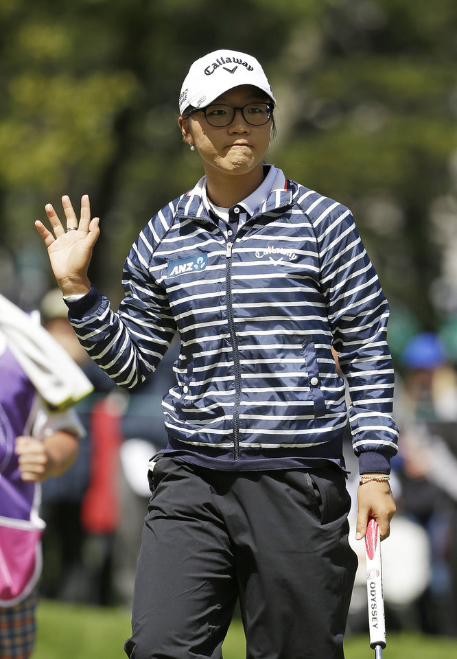 Photo - Lydia Ko of New Zealand, waves after making a birdie putt on the sixth green of the Lake Merced Golf Club during the third round of the Swinging Skirts LPGA Classic golf tournament on Saturday, April 26, 2014, in Daly City, Calif. (AP Photo/Eric Risberg)