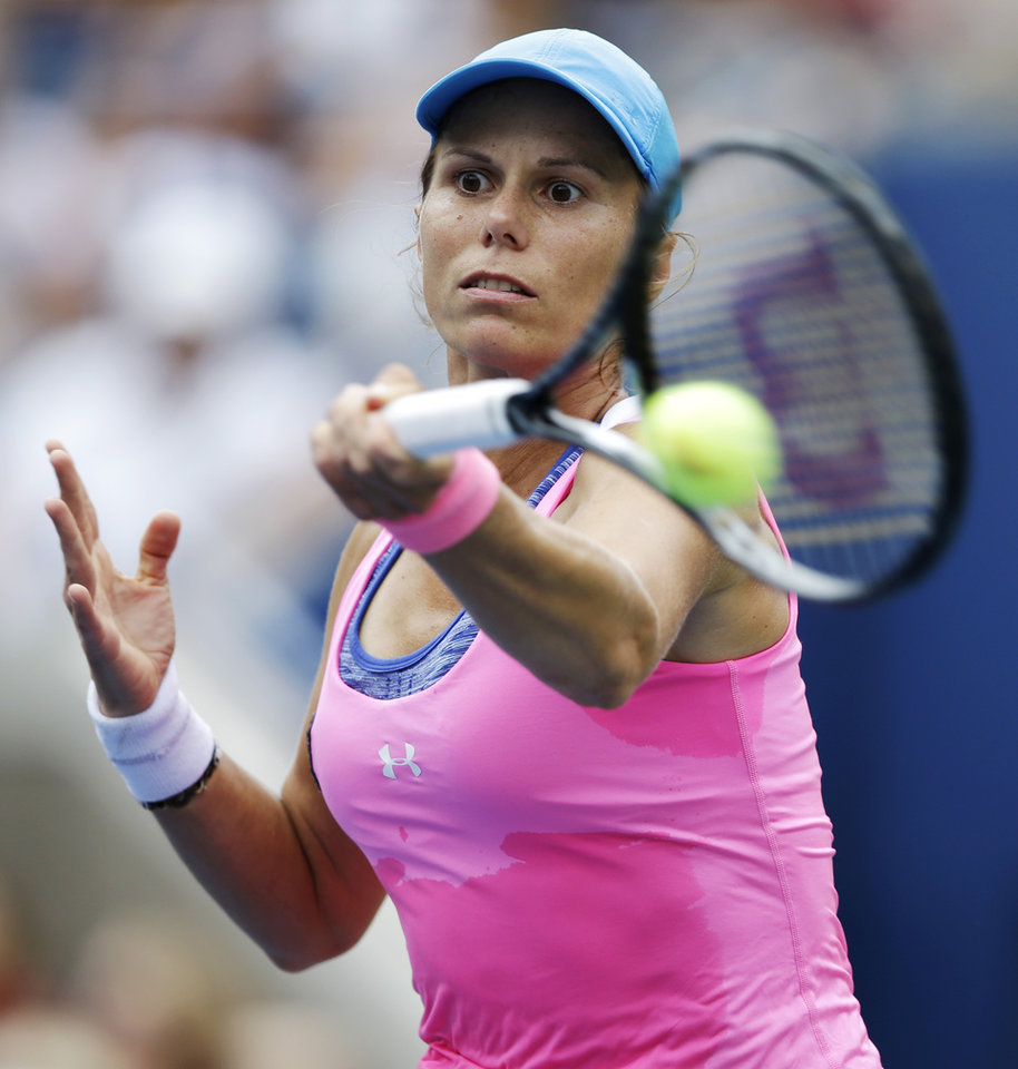 Photo - Varvara Lepchenko, of the United States, returns a shot against Serena Williams, of the United States, during the third round of the 2014 U.S. Open tennis tournament, Saturday, Aug. 30, 2014, in New York. (AP Photo/Darron Cummings)