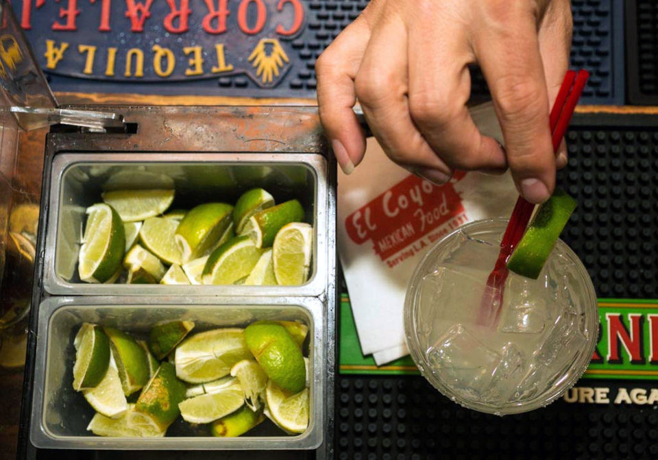 Photo - In this Monday, April 28, 2014 photo, bartender Mario Sanchez crafts a margarita cocktail at the bar of El Coyote, a Mexican restaurant in Los Angeles. Thousands of restaurateurs from coast to coast who have fallen victim to the Great Green Citrus Crisis of 2014. The lime, that humble little fruit that sort of resembles a green golf ball, has skyrocketed in price in recent weeks, quadrupling or, in some areas, going even higher. (AP Photo)