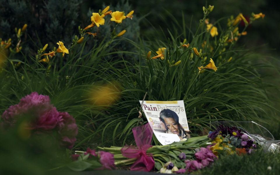 Photo - A memorial is shown outside a gate at the home of Maya Angelou in Winston-Salem, N.C., Wednesday, May 28, 2014. Angelou, a Renaissance woman and cultural pioneer, died Wake Forest University said in a statement Wednesday, May 28, 2014. She was 86. (AP Photo/Gerry Broome)