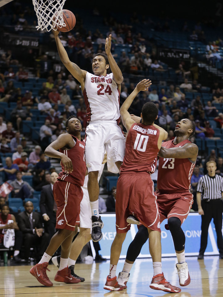 Photo - Stanford's Josh Huestis puts up a shot against Washington State in the first half of an NCAA Pac-12 conference tournament college basketball game, Wednesday, March 12, 2014, in Las Vegas. (AP Photo/Julie Jacobson)