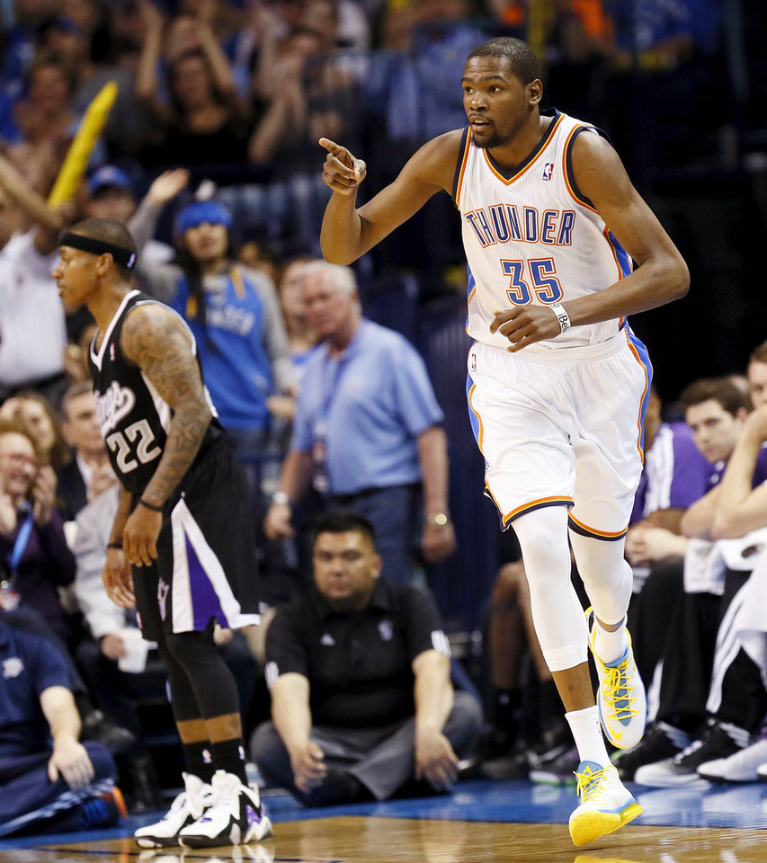 Photo - Oklahoma City's Kevin Durant (35) reacts in front of Sacramento's Isaiah Thomas (22) after hitting a shot during an NBA basketball game between the Oklahoma City Thunder and the Sacramento Kings at Chesapeake Energy Arena in Oklahoma City, Monday, April 15, 2013. Oklahoma City won, 104-95. Photo by Nate Billings, The Oklahoman
