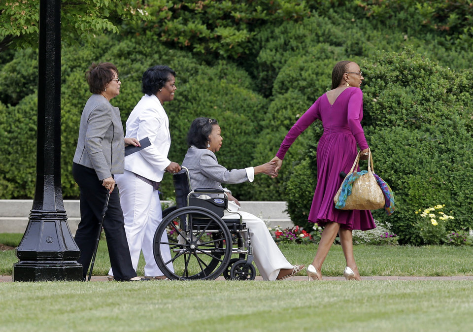 Photo - Susan L. Taylor, right, assists friends outside Wait Chapel before a memorial service for poet and author Maya Angelou at Wait Chapel. at Wake Forest University in Winston-Salem, N.C., Saturday, June 7, 2014. Former President Bill Clinton and Oprah Winfrey are joining First Lady Michelle Obama at the service. (AP Photo/Chuck Burton)