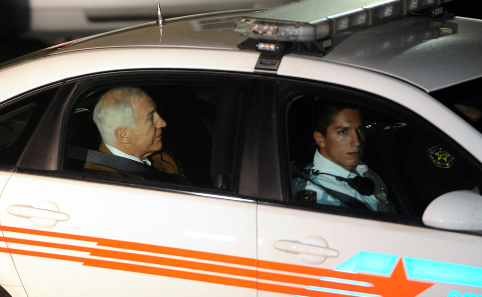 Photo -   Jerry Sandusky leaves the Centre County Courthouse Friday, June 22, 2012, after being found guilty in his sexual abuse trial, at the Centre County Courthouse, in Bellefonte, Pa. Sandusky was convicted of sexually assaulting 10 boys over 15 years, accusations that had sent shock waves through the college campus known as Happy Valley and led to the firing of Penn State's beloved Hall of Fame coach, Joe Paterno. (AP Photo/Centre Daily Times, Nabil K. Mark) MANDATORY CREDIT; MAGS OUT; ALTOONA MIRROR OUT; LOCK HAVEN EXPRESS OUT; CLEARFIELD PROGRESS OUT; HARRISBURG PATRIOT NEWS OUT; CENTRE COUNTY GAZETTE OUT; STATECOLLEGE.COM OUT