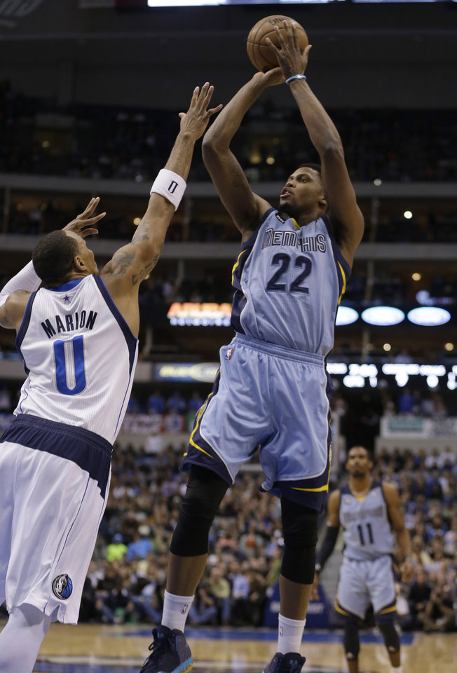 Memphis Grizzlies small forward Rudy Gay (22) shoots over Dallas Mavericks small forward Shawn Marion (0) during the first half of an NBA basketball game on Saturday, Jan. 12, 2013, in Dallas. (AP Photo/LM Otero)
