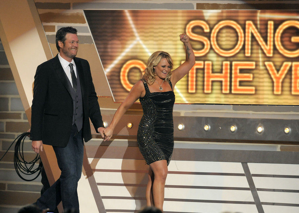 "Miranda Lambert, right, and Blake Shelton walk on stage to accept the award for song of the year for ""Over You"" at the 48th Annual Academy of Country Music Awards at the MGM Grand Garden Arena in Las Vegas on Sunday, April 7, 2013. (Photo by Chris Pizzello/Invision/AP) ORG XMIT: NVPM264"