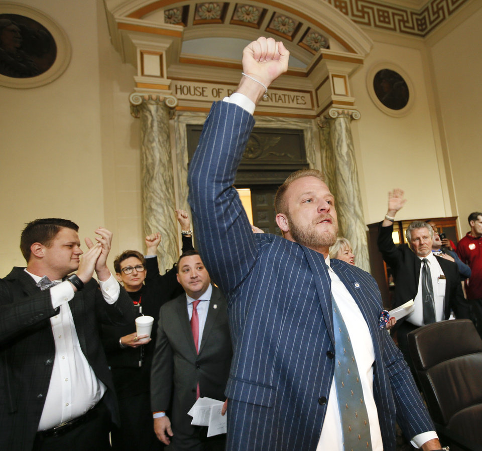 Photo -  State Rep. Collin Walke, D-Oklahoma City, and other representatives acknowledge protesters outside the House chamber Tuesday during the second day of a walkout by Oklahoma teachers at the state Capitol in Oklahoma City. [Photo by Nate Billings, The Oklahoman]