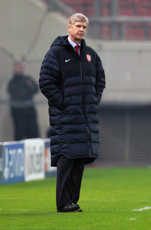 Photo - Arsenal's coach Arsene Wenger watches the group B Champions League soccer match against Olympiakos in the port of Piraeus, near Athens, Tuesday, Dec. 4, 2012. (AP Photo/Thanassis Stavrakis)