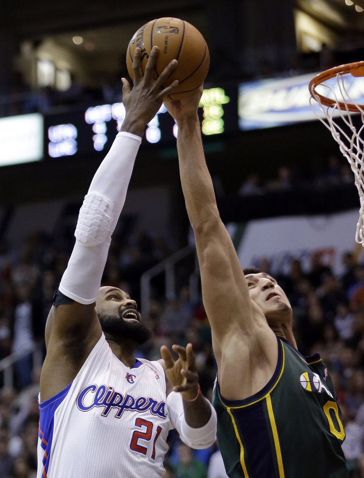 Utah Jazz center Enes Kanter (0) blocks the shoot of Los Angeles Clippers center Ronny Turiaf (21) in the second quarter during an NBA basketball game on Friday, Dec. 28, 2012, in Salt Lake City. (AP Photo/Rick Bowmer)