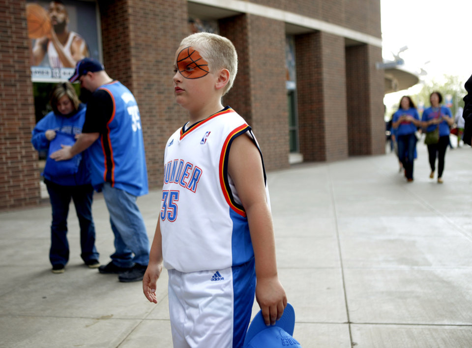 Photo - Thunder fan Casey Whiting, 8, makes his way to the arena before the NBA basketball game between the Oklahoma City Thunder and the Los Angeles Clippers at Chesapeake Energy Arena in Oklahoma City, Wednesday, April 11, 2012. Photo by Bryan Terry, The Oklahoman