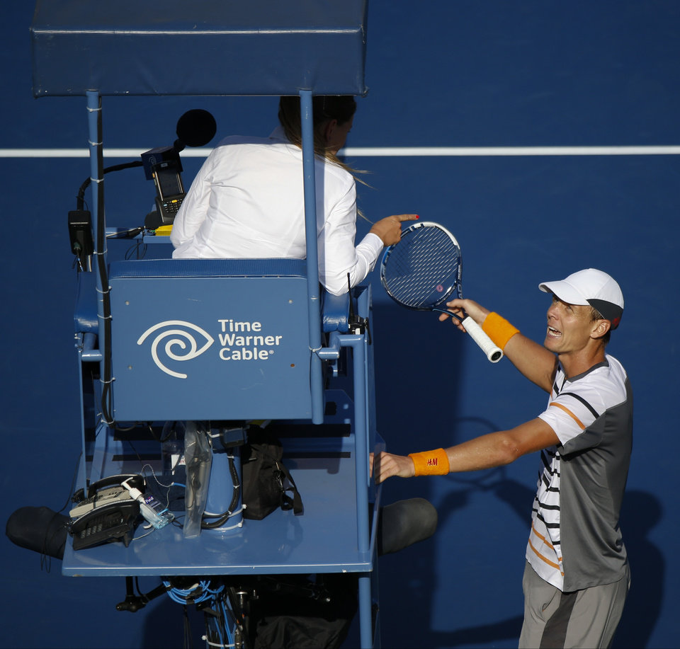 Photo - Tomas Berdych, of the Czech Republic, argues with the chair umpire who ruled that a ball hit by Marin Cilic, of Croatia, bounced twice before hitting Berdych's racket during the quarterfinals of the 2014 U.S. Open tennis tournament, Thursday, Sept. 4, 2014, in New York. (AP Photo/Seth Wenig)