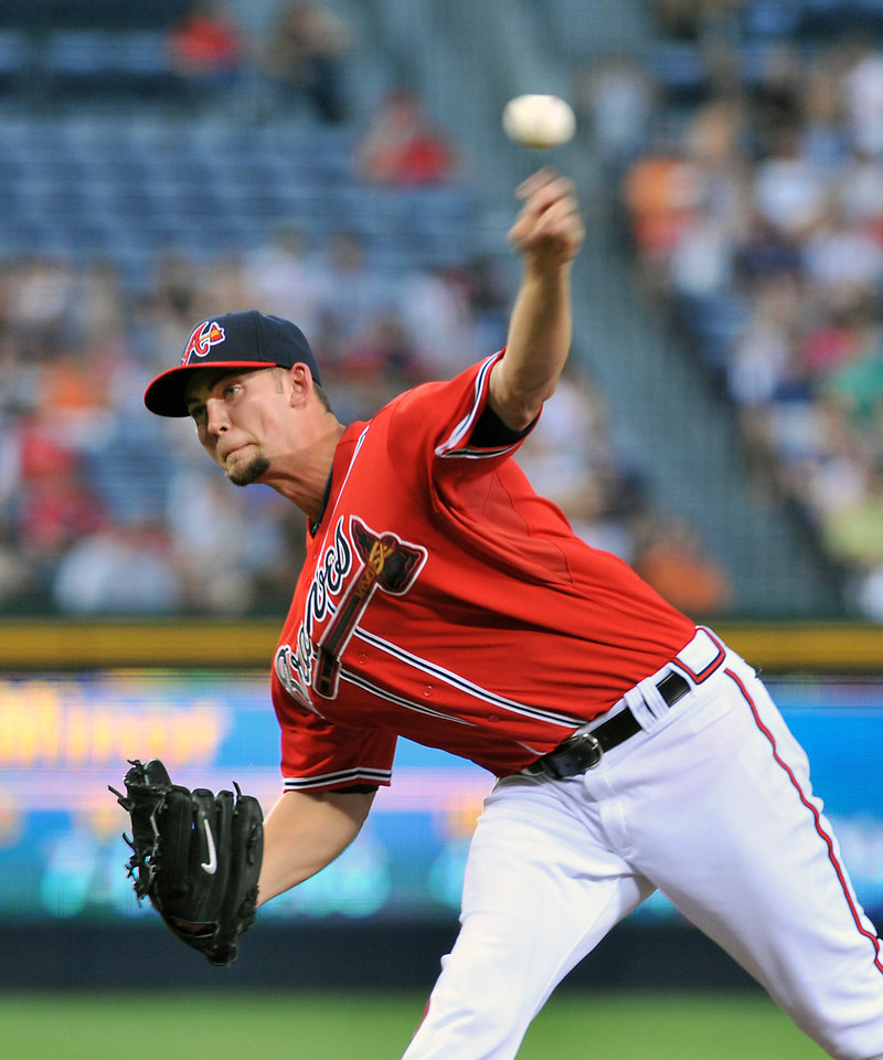 Photo -   Atlanta Braves starter Mike Minor delivers to the Philadelphia Phillies during the second inning of a baseball game on Friday, Aug. 31, 2012, at Turner Field in Atlanta. (AP Photo/Gregory Smith)