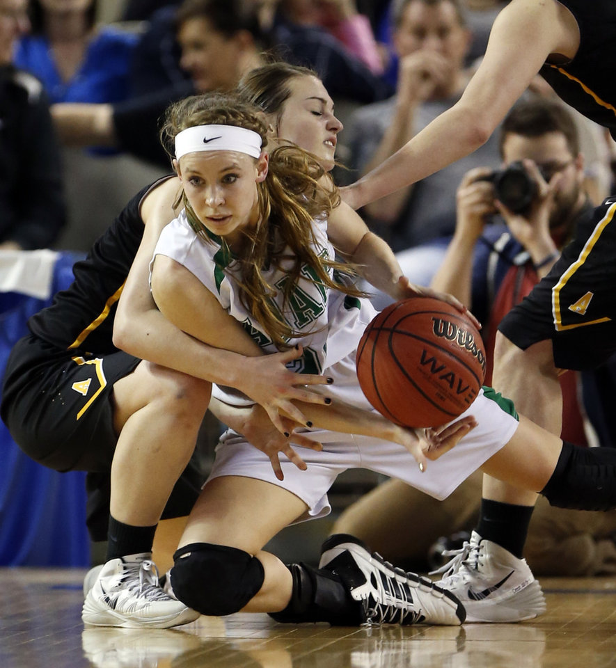 Photo - Alva's Jaden Hobbs, back, tries to tie up Bailey Stephens as the Adair Lady Warriors play the Alva Lady Goldbugs in the finals of the State Class 3A Girls Basketball Tournament at the Fairgrounds Arena on Saturday, March 15, 2014, in Oklahoma City, Okla. Photo by Steve Sisney, The Oklahoman
