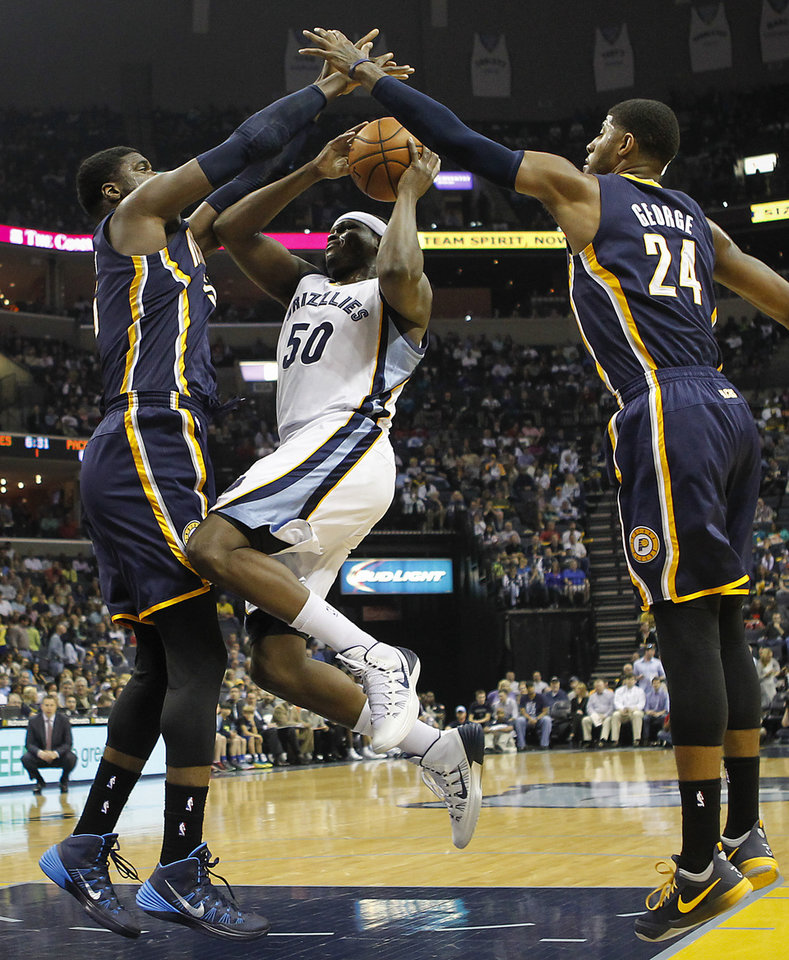 Memphis Grizzlies forward Zach Randolph (50) goes to the basket against Indiana Pacers center Roy Hibbert (55) and forward Paul George (24) in the first half of an NBA basketball game on Saturday, March 22, 2014, in Memphis, Tenn. (AP Photo/Lance Murphey)