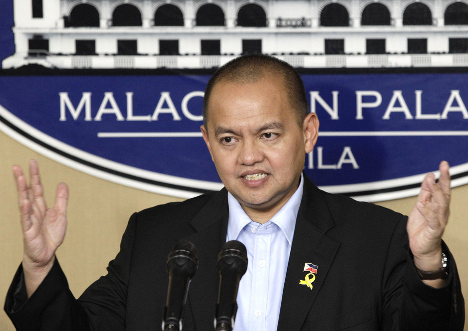 Photo -   Philippine government negotiator Marvic Leonen gestures as he answers questions from reporters after meeting with Philippine President Benigno Aquino III at the Malacanang presidential palace in Manila, Philippines on Monday, Oct. 8, 2012. The Philippine government and the country's largest Muslim rebel group reached a preliminary peace deal that is a major breakthrough toward ending a decades-long insurgency that killed tens of thousands and held back development in the south. (AP Photo/Aaron Favila)