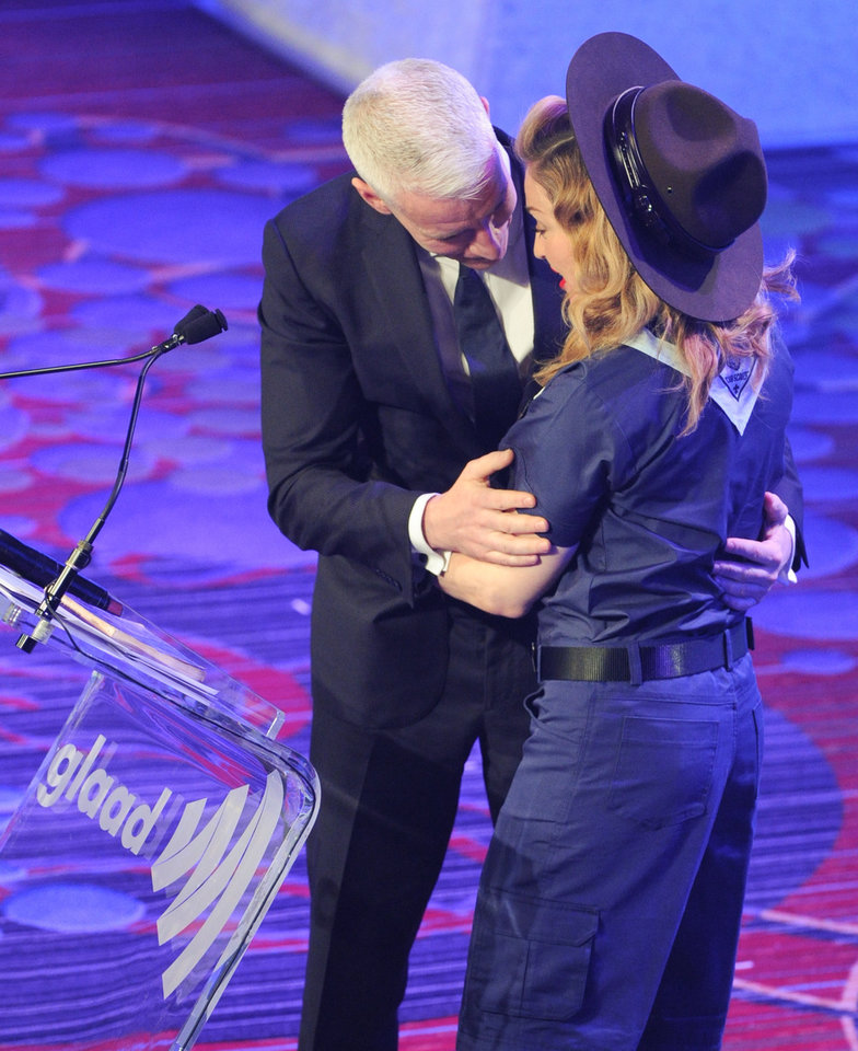 Photo - Madonna presents CNN news anchor Anderson Cooper with the Vito Russo Award at the 24th Annual GLAAD Media Awards at the Marriott Marquis on Saturday March 16, 2013 in New York. Madonna presented CNN news anchor Anderson Cooper with the Vito Russo Award. (Photo by Evan Agostini/Invision/AP)