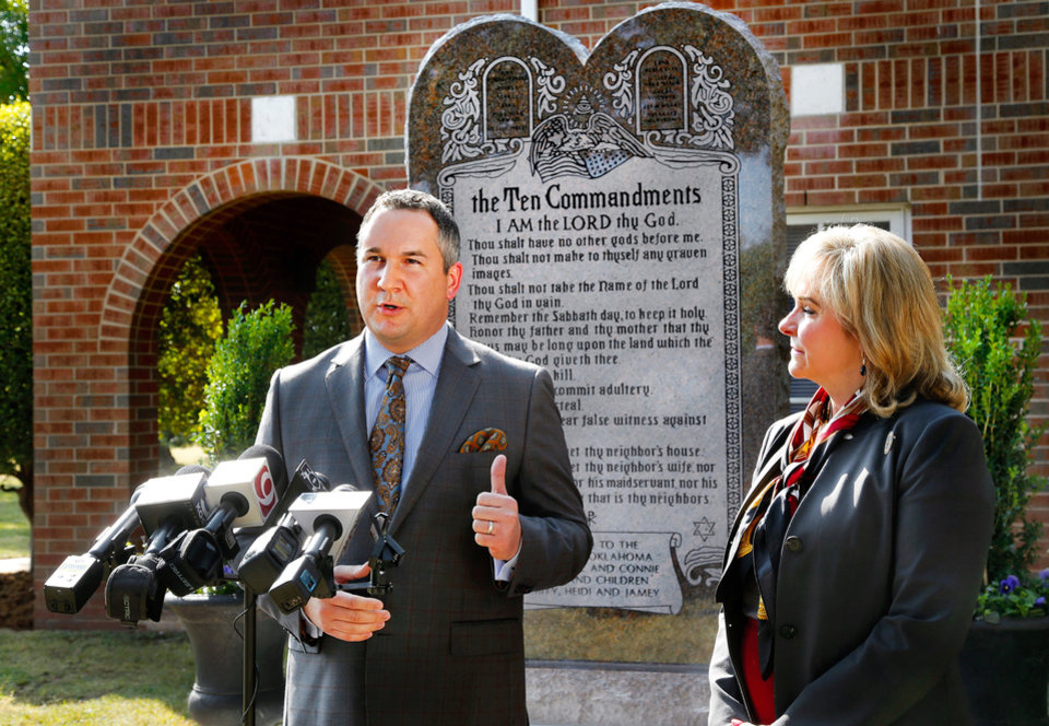 "Photo - Governor Mary Fallin, right, state Representative Mike Ritze, not pictured,  and the Oklahoma Council of Public Affairs (OCPA) announced Tuesday, Oct. 5, 2015, the relocation of the Ten Commandments monument from the Oklahoma State Capitol to OCPAÃ•s campus, located on private property on the northwest corner of NE 13 and Lincoln Blvd., ten blocks south of the capitol complex. The Oklahoma Supreme Court ordered the monument to be removed from the Capitol grounds in June, saying the Oklahoma Constitution prohibited the state from displaying it. The state appealed that decision but could not get the Supreme Court ruling overturned. Fallin thanked OCPA for housing the monument and said she would work with lawmakers to put a proposed Constitutional change to a vote of the people, allowing the monument to eventually return to the Capitol.  OCPA is a public policy research organization that focuses on state-based issues from a perspective of limited government, individual liberty and a free-market economy. Ã'OCPA has been committed to providing solutions to make Oklahoma a better state for more than 22 years,Ã"" said Michael Carnuccio, left, president of OCPA. Ã'Typically, we do so with fact-based research and ideas rooted in free enterprise and the rule of law. Today, however, we are pleased to provide a home for the monument while lawmakers pursue legislative solutions that allow it to be returned to the Capitol grounds.Ã""  Rep. Ritze raised the private dollars to create the monument and then gifted it to the state. Photo by Jim Beckel, The Oklahoman."