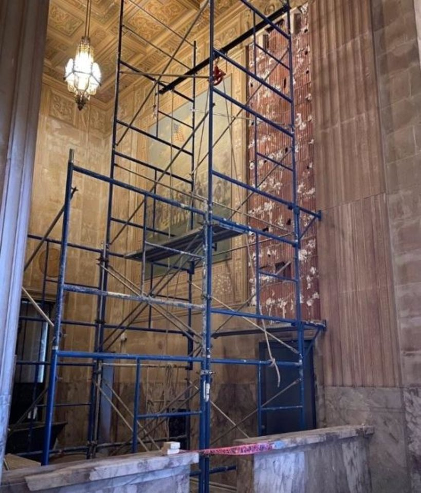 Photo -  Wall panels in the Great Banking Hall are removed to inspect the walls for any damage. [PROVIDED]