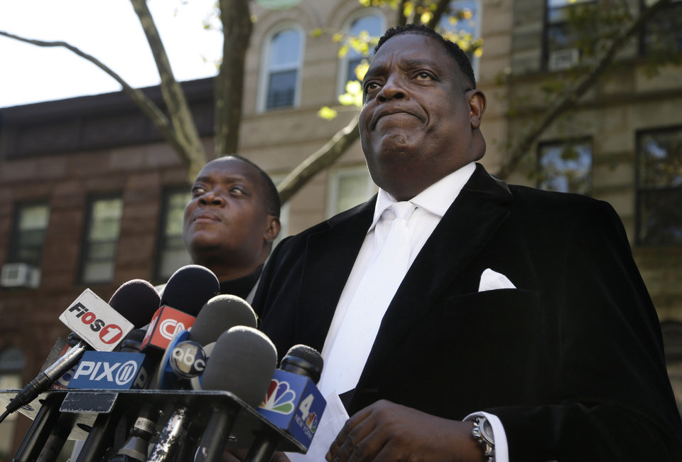 Photo - Bishops Gerald Seabrooks, right, and Willie Billips pause as they address reporters after Cathleen Alexis, mother of Washington Navy Yard gunman Aaron Alexis, made a statement in New York's Brooklyn borough on Wednesday, Sept. 18, 2013. Cathleen Alexis said that she does not know why her son did what he did and she will never be able to ask him. Aaron Alexis opened fire Monday, killing 12 people, before he was killed in a shootout with police. (AP Photo/Seth Wenig)
