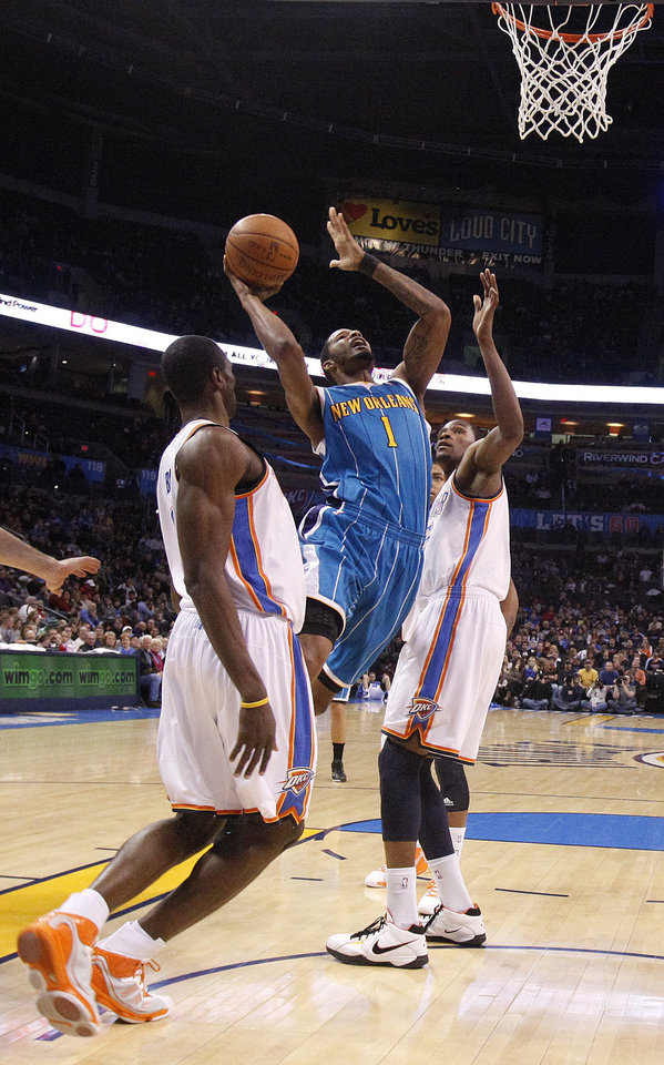 Photo - New Orleans' Trevor Ariza (1) shoots as Oklahoma City's Jeff Green (22) and Oklahoma City's Kevin Durant (35) defend during the NBA basketball game between Oklahoma City Thunder and New Orleans Hornet, Wednesday, Feb. 2, 2011 at the Oklahoma City Arena. Photo by Sarah Phipps, The Oklahoman