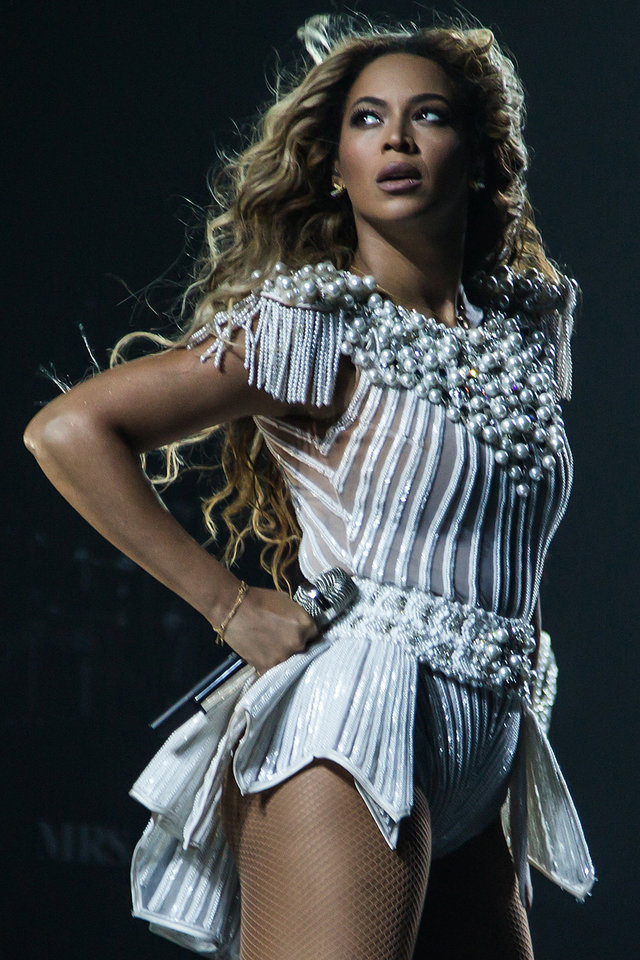 "Singer Beyonce brought her ""Mrs. Carter Show World Tour 2013"" to Oklahoma City on Friday night.  She's shown here in a San Jose, California, performance on July 2.  (Photo by Robin Harper/Invision for Parkwood Entertainment/AP Images) <strong>Robin Harper</strong>"
