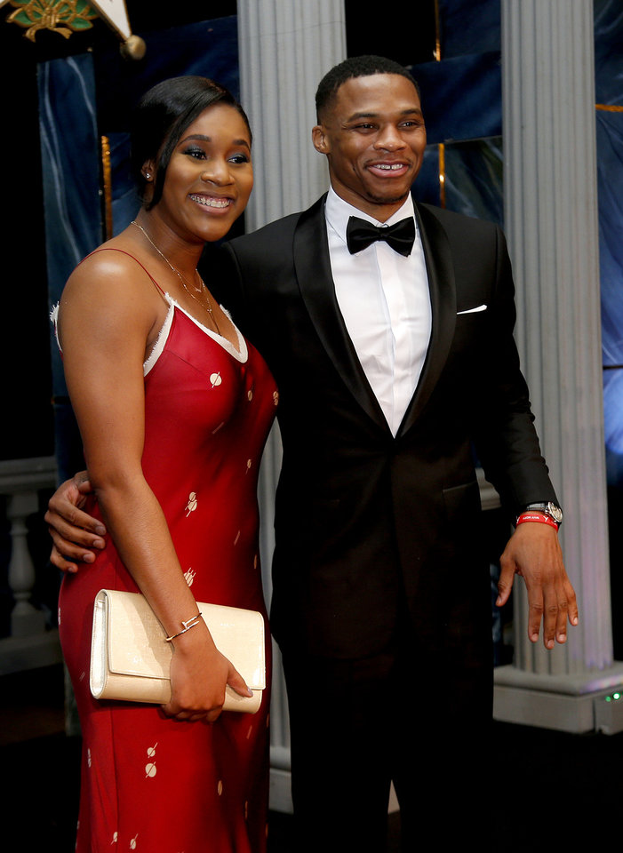 Photo - Russell Westbrook takes a photo wit his wife Nina Westbrook before the induction ceremony for the Oklahoma Hall of Fame at the Cox Convention Center in Oklahoma City in Oklahoma City,  Thursday, Nov. 17, 2016. Photo by Sarah Phipps, The Oklahoman