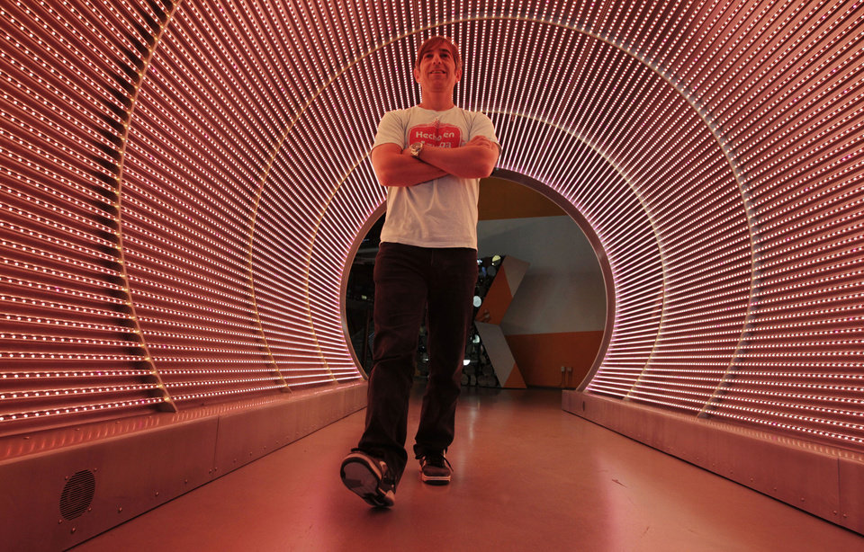 "In this May 2, 2012 photo, Zynga CEO Mark Pincus walks through the ""Time Tunnel"" in the lobby of Zynga headquarters in San Francisco. Zynga Inc. reports quarterly financial results after the market closes Wednesday, April 24, 2013. (AP Photo/Paul Sakuma)"