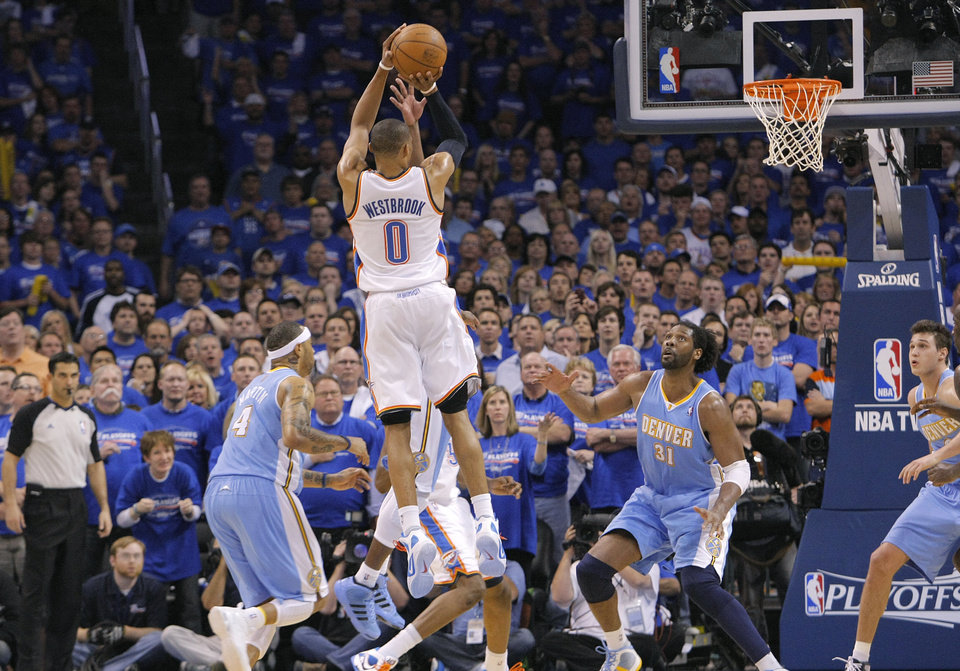 Oklahoma City's Russell Westbrook (0) puts up the shot that put the Thunder up for good over Denver during the first round NBA playoff game between the Oklahoma City Thunder and the Denver Nuggets on Sunday, April 17, 2011, in Oklahoma City, Okla. Photo by Chris Landsberger, The Oklahoman