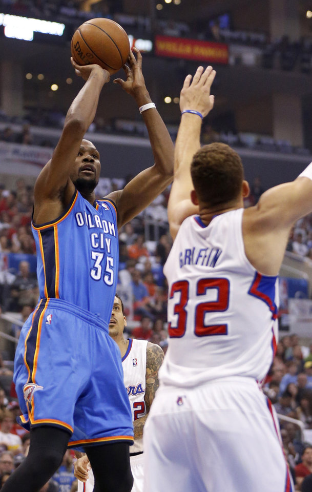 Photo - Oklahoma City's Kevin Durant (35) shoots over Los Angeles' Blake Griffin (32) during Game 4 of the Western Conference semifinals in the NBA playoffs between the Oklahoma City Thunder and the Los Angeles Clippers at the Staples Center in Los Angeles, Sunday, May 11, 2014. Photo by Nate Billings, The Oklahoman