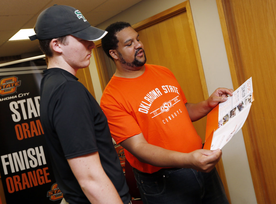 Photo -  Sophomore Max Klouse, 18, talks with e-recruitment specialist Marcus Harman during the Orange Ticket enrollment event July 13 at Oklahoma State University-Oklahoma City. [Photo by Nate Billings, The Oklahoman]