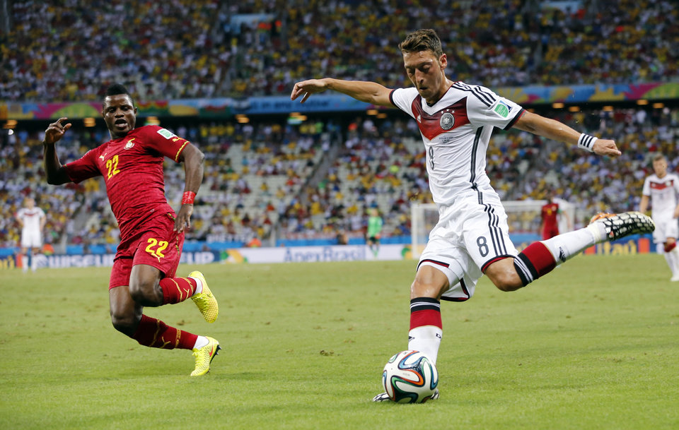 Photo - Germany's Mesut Ozil crosses the ball during the group G World Cup soccer match between Germany and Ghana at the Arena Castelao in Fortaleza, Brazil, Saturday, June 21, 2014. (AP Photo/Matthias Schrader)