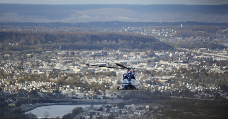 New Jersey Gov. Chris Christie's helicopter is seen through the windshield of a New Jersey National Guard Black Hawk helicopter over northern New Jersey, Saturday, Nov. 3, 2012. Christie toured a section of Little Ferry, N.J., that was flooded when Superstorm Sandy caused a tidal surge on the Hackensack River that overtook a natural berm protecting the town. (AP Photo/The Star-Ledger, David Gard, Pool)