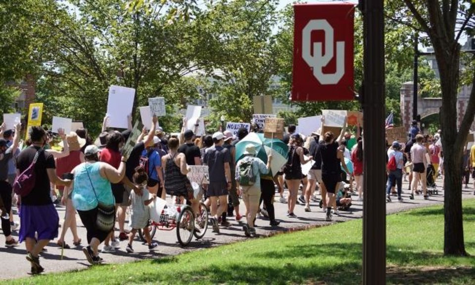 Photo -  Protesters march down University Boulevard on Saturday during a protest in Norman. [Ellie Melero/The Oklahoman]