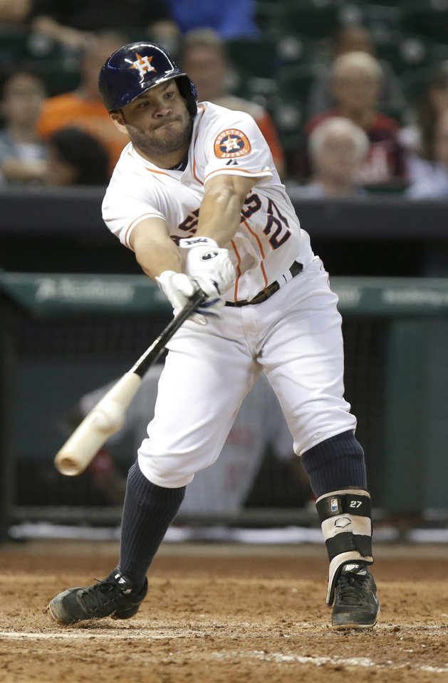 Photo - Houston Astros' Jose Altuve connects for a double down the right-field line against the Cincinnati Reds in the eighth inning of a baseball game Tuesday, Sept. 17, 2013, in Houston. (AP Photo/Pat Sullivan)